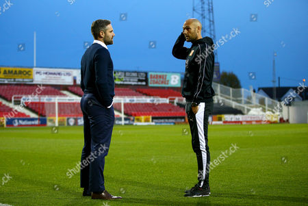 Oldham Athletic manager David Dunn talks with Swindon Town coach Luke Williams before the Sky Bet League One match between Swindon Town and Oldham Athletic played at The County Ground, Swindon on October 20th 2015
