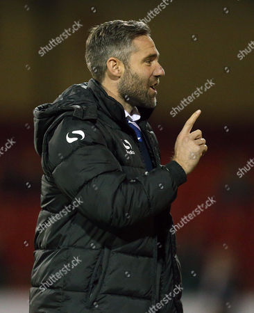 Oldham Athletic manager David Dunn celebrates his sides opening goal scored by Mike Jones during the Sky Bet League One match between Swindon Town and Oldham Athletic played at The County Ground, Swindon on October 20th 2015