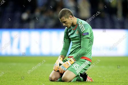 Maccabi Tel Aviv's Serbian goalkeeper Predrag Rajkovic reacts after Porto's goal