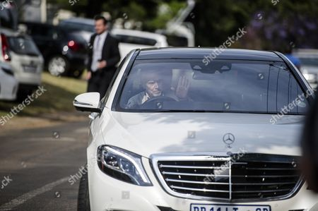Arnold Pistorius arrives at his house where Oscar Pistorius is now staying
