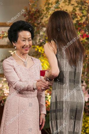 Sylvie Guillem receives a medal from Princess Hanako Hitachi of Japan
