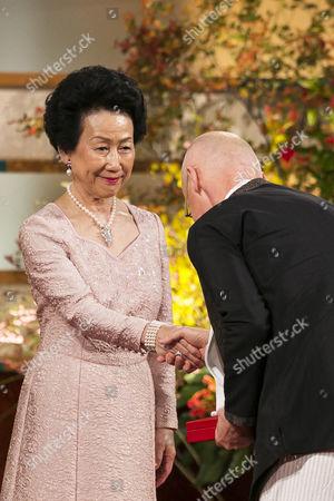 Wolfgang Laib receives a medal from Princess Hanako Hitachi of Japan