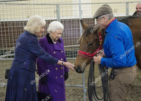 Stock Photo of Camilla Duchess of Cornwall and Queen Elizabeth II with Monty Roberts