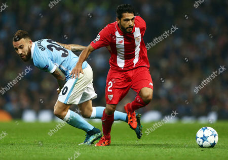 Benoit Tremoulinas of Sevilla and Nicolas Otamendi of Manchester City during the UEFA Champions League Group D match between Manchester City and Sevilla played at the Etihad Stadium, Manchester on October 21st 2015