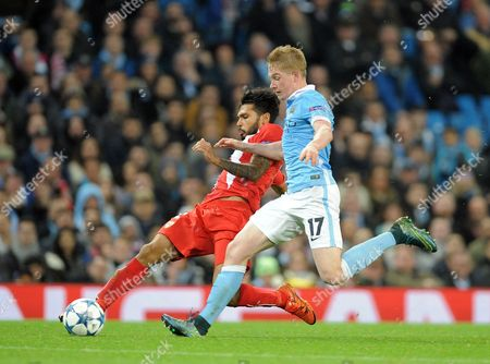 Benoit Tremoulinas of Sevilla tackles Kevin De Bruyne of Manchester City during the UEFA Champions League Group D match between Manchester City and Sevilla played at the Etihad Stadium, Manchester on October 21st 2015