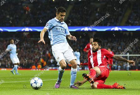 Benoit Tremoulinas of Sevilla tackles Jesus Navas of Manchester City