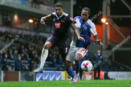 Stock Image of Derby County's Simon Dawkins and Blackburn Rovers Nathan Delfouneso during the Sky Bet Championship match between Blackburn Rovers and Derby County played at Ewood Park on October 21st 2015