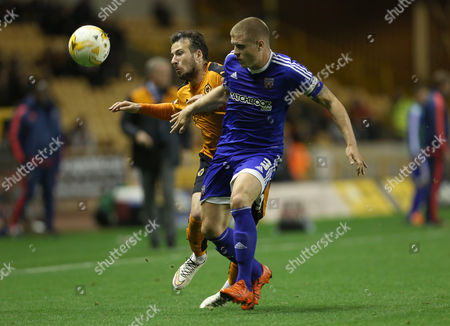 Stock Photo of Wolverhampton Wanderers Adam Le Fondre battles with Brentford's Jake Bidwell during the Sky Bet  Championship League match between Wolverhampton Wanderers and Brentford played at Molineux Stadium, Wolverhampton, on October 20th 2015