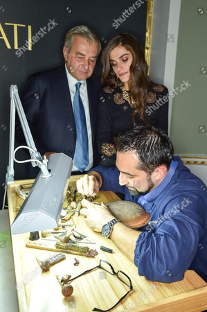 Andrea Buccellati and Elisa Sednaoui watch a jeweller at work