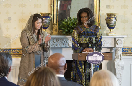 U.S. First Lady Michelle Obama and Mrs. Kalsoom Nawaz Sharif, spouse of Pakistani Prime Minister Nawaz Sharif, in the Blue Room of the White House deliver brief remarks announcing a new partnership to further adolescent girls' education in Pakistan.