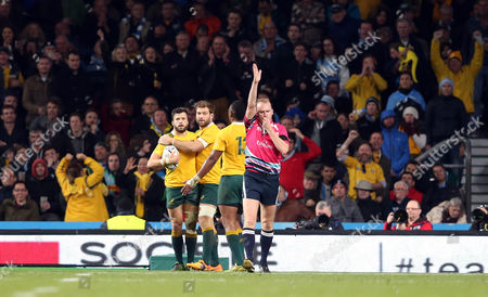 Adam Ashley-Cooper of Australia looks up at Referee: Wayne Barnes  (awarding  try) as he touches down for his 3rd try and crucially giving Australia breathing space in the final 10 minutes