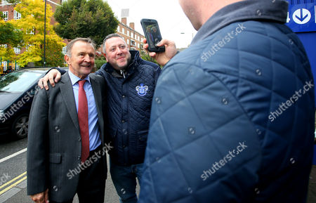 John Hollins poses for photos with fans during the Sky Bet Championship match between Queens Park Rangers and Milton Keynes Dons played at Loftus Road, London on 24th October 2015