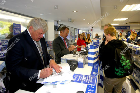 QPR legends Ian Gillard and John Hollins sign autographs in the club shop before the Sky Bet Championship match between Queens Park Rangers and Milton Keynes Dons played at Loftus Road, London on 24th October 2015