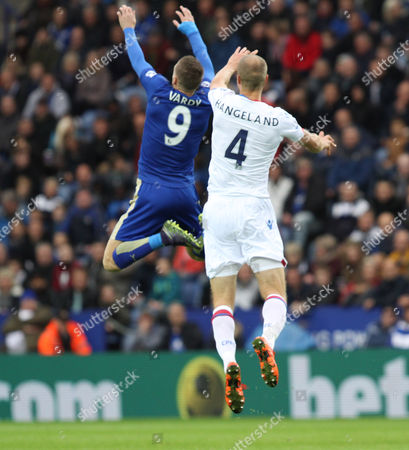 Jamie Vardy, Leicester City forward, jumps for the ball with Brede Hangeland, Crystal Palace defender,