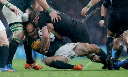South AfricaÕs Fourie du Preez is tackled by New ZealandÕs Richie McCaw