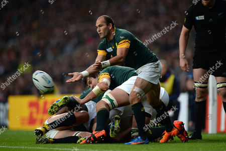Fourie du Preez of South Africa gets the ball away.