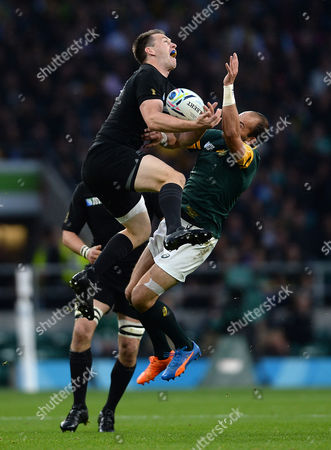 Ben Smith of New Zealand and Fourie du Preez of South Africa compete for high ball.