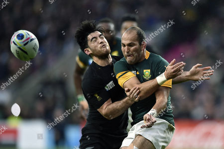 Fourie du Preez of South Africa passes the ball before being tackled by Nehe Milner-Skudder of New Zealand