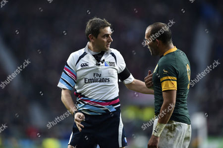 Referee Jerome Garces speaks to Fourie du Preez of South Africa