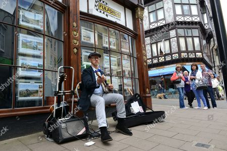 Paul Scofield of Sidmouth playing blues guitar at Dart Music Festival at Dartmouth Devon Uk 2015