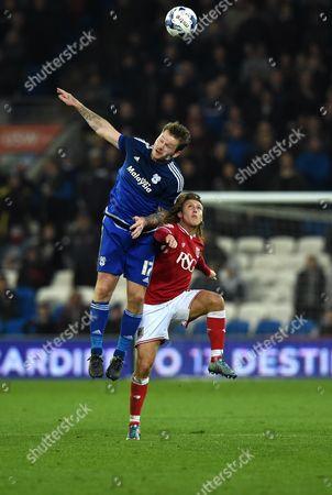 Luke Freeman of Bristol City battles for the high ball with Federico Macheda of Cardiff City