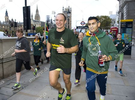 Former South African rugby player Francois Pienaar takes a morning jog