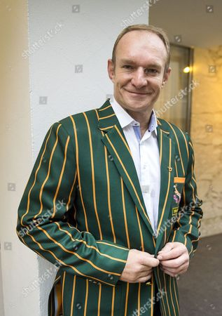 Francois Pienaar poses for a picture outside his hotel after the event.