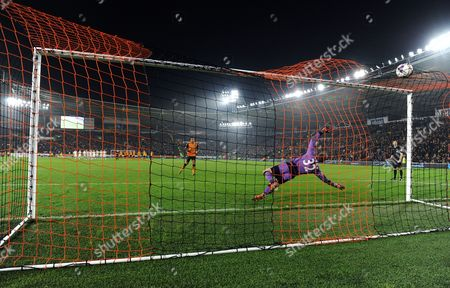Tom Huddlestone of Hull City scores a great penalty during the shoot out past Goalkeeper Mark Schwarzer of Leicester City during the Capital One Cup match between Hull City v Leicester City played at the KC Stadium, Hull on October 27th 2015