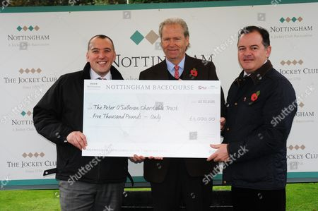 Stock Picture of Presentation for the Sir Peter O'Sullevan Trust the day after Sir Peter's Memorial. L-R James Knox, General Manager at Nottingham, Geoffrey Hughes and Ed Ware at Nottingham.