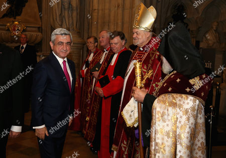 The Catholicos of All Armenians His Holiness Karekin II greets the President of the Republic of Armenia Serzh Sargysyan as the Bishop of London Right Reverend Richard Chartres looks