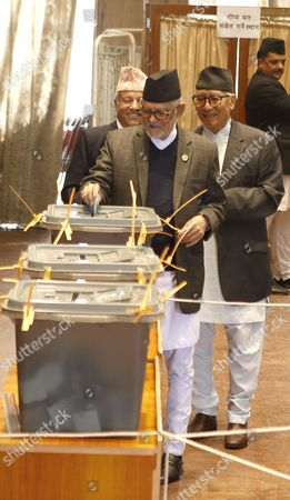 Nepal's former prime minister and chairman of Nepali Congress party Sushil Koirala casts his vote in Kathmandu