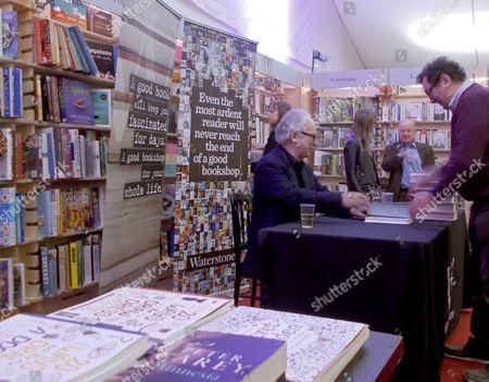 Author Peter Carey at a book signing, Cheltenham Literature Festival.