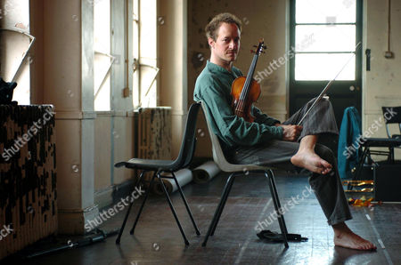 Stock Image of Anthony Marwood, violinist, breaking from rehearsals for 'The Soldiers Tale' at Toynbee Hall studios