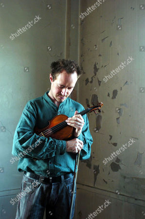 Anthony Marwood, violinist, breaking from rehearsals for 'The Soldiers Tale' at Toynbee Hall studios