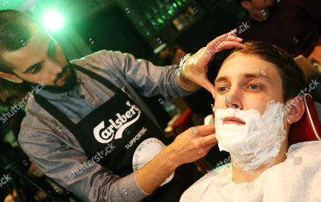 Chris Stark gets complimentary shave at Ted's Grooming Room in London with Carlsberg's new male grooming range to help raise money for the Movember foundation