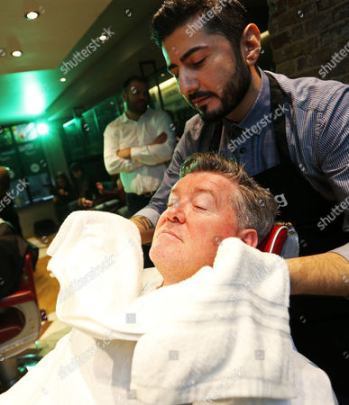 Geoff Shreeves gets a complimentary shave at Ted's Grooming Room in London with Carlsberg's new male grooming range to help raise money for the Movember foundation