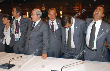 3rd L to R: Vice president of the Paris bid Jean Paul Huchon, Paris Mayor Bertrand Delanoe, France's Sports Minister Jean Francois Lamour and Lagardere Group's CEO Arnaud Lagardere reacting after the announcement of the host city of the 2012 Summer Olympic Games