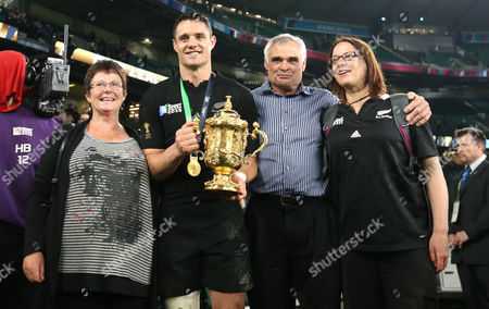 Dan Carter of New Zealand with his parents Neville and Bev Carter, and his older sister, Sarah with the Webb Ellis cup after the Rugby World Cup 2015 Final match between Australia and New Zealand played at Twickenham Stadium, London, on October 31st 2015