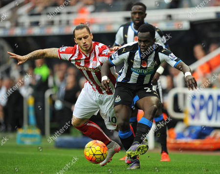 Cheik Tiote of Newcastle United (right) fends off Marko Arnautovic of Stoke City during the Barclays Premier League match between Newcastle United and Stoke City played at St. James? Park, Newcastle upon Tyne, on the 31st October 2015