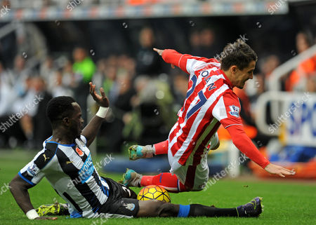 Cheik Tiote of Newcastle United tackles Bojan Krkic of Stoke City during the Barclays Premier League match between Newcastle United and Stoke City played at St. James? Park, Newcastle upon Tyne, on the 31st October 2015