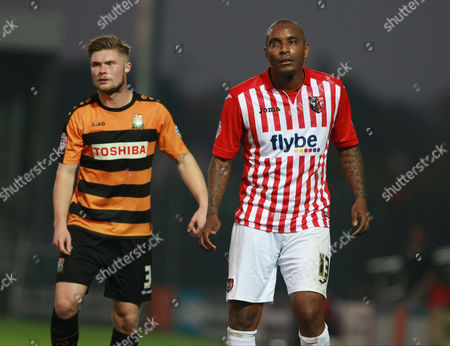 Barnet defender Elliott Johnson keeps tight to Exeter City striker Clinton Morrison   during the Sky Bet League 2 match between Barnet and Exeter City at The Hive Stadium, London
