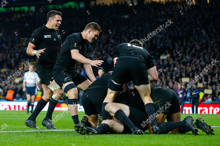 New Zealand Fly-Half Daniel Carter celebrates after New Zealand replacement Beauden Barrett scores a try towards the end of the match