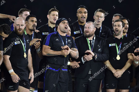 Liam Messam of New Zealand leads the squad into a song after the match