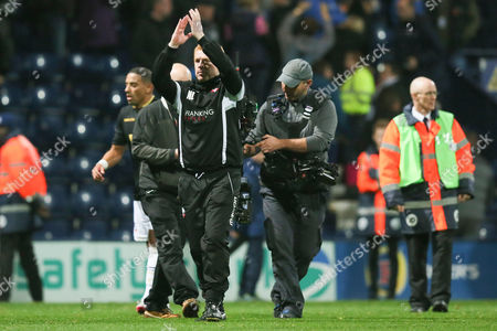 Bolton Wanderers manager Neil Lennon applauds the fans at the end of the Sky Bet Championship match between Preston North End and Bolton Wanderers played at Deepdale on October 31st  2015
