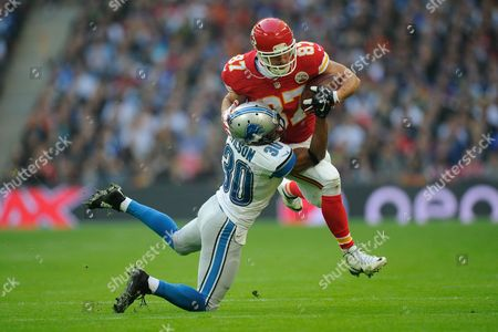 Kansas City Chiefs Tight End Travis Kelce is tackled by Detroit Lions Cornerback Josh Wilson (30) during the NFL Week 8 match between Kansas City Chiefs and Detroit Lions played at Wembley Stadium, London on November 1st 2015