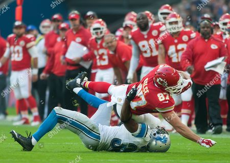 Detroit Lions Defensive Back Josh Wilson [#30] tackles Kansas City Chiefs Tight End Travis Kelce (#87), International Series, Game 14, Wembley Stadium, London, Britain