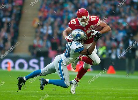 Kansas City Chiefs Tight End Travis Kelce (#87) is tackled by Detroit Lions Defensive Back Josh Wilson [#30], International Series, Game 14, Wembley Stadium, London, Britain