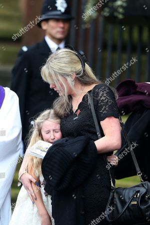Jen Phllips comforts daughter Abigail on the steps of Liverpool Anglican Cathedral after the service of  PC Dave Phillips in Liverpool, Merseyside