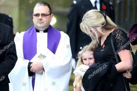 Jen Phillips comforts daughter Abigail on the steps of Liverpool Anglican Cathedral after the service of  PC Dave Phillips in Liverpool, Merseyside
