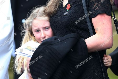 Stock Photo of Jen Phllips comforts daughter Abigail Phillips on the steps of Liverpool Anglican Cathedral after the service of  PC Dave Phillips in Liverpool, Merseyside